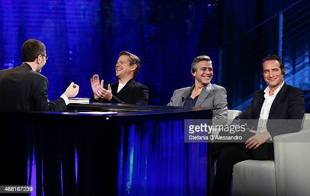 Fabio Fazio Matt Damon George Clooney and Jean Dujardin attend 'Che Tempo Che Fa' TV Show on February 9 2014 in Milan Italy