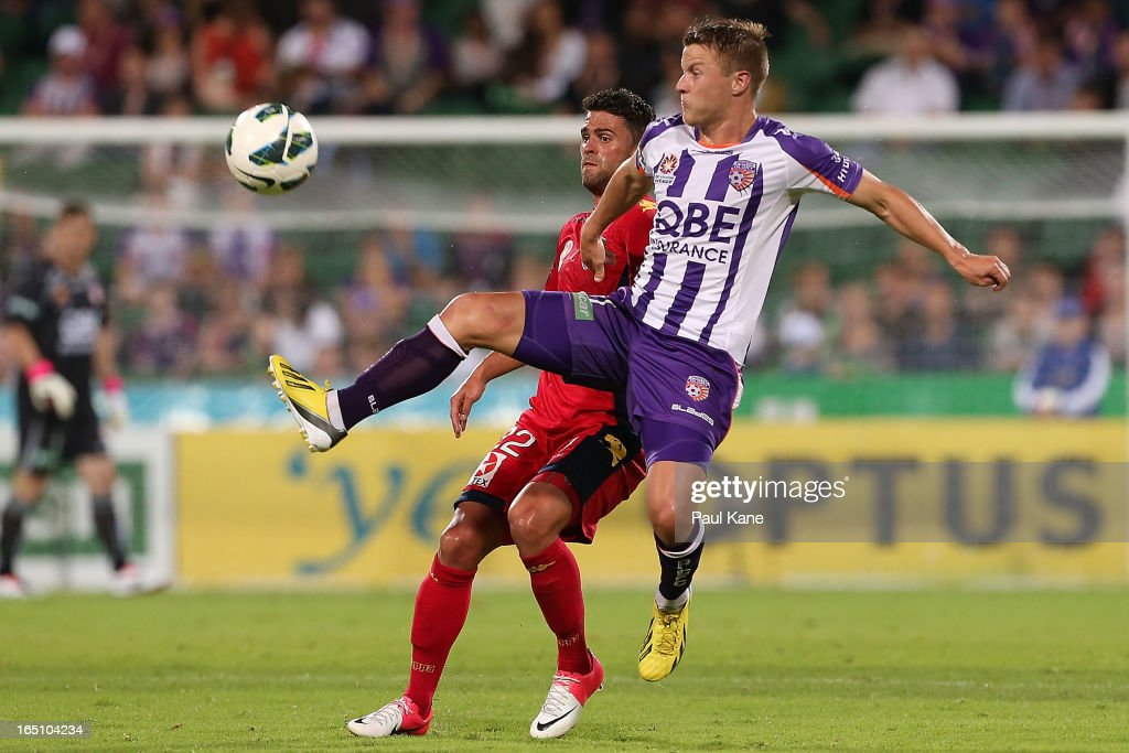 Fabio Ferreira of Adelaide and Scott Jamieson of the Glory contest for the ball during the round twenty seven A-League match between Perth Glory and Adelaide United at nib Stadium on March 30, 2013 in Perth, Australia.