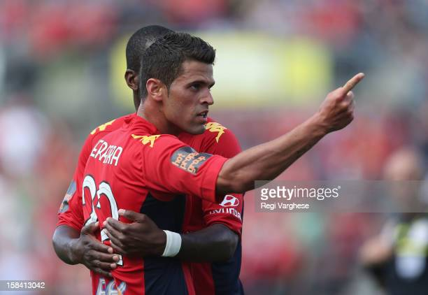 Fabio Ferreira of Adelaide celebrates scoring the third goal with team mate Bruce Djite during the round 11 ALeague match between Adelaide United and...