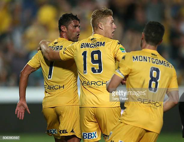 Fabio Ferreira of the Mariners celebrates a goal with team mate Josh Bingham during the round 16 ALeague match between the Central Coast Mariners and...