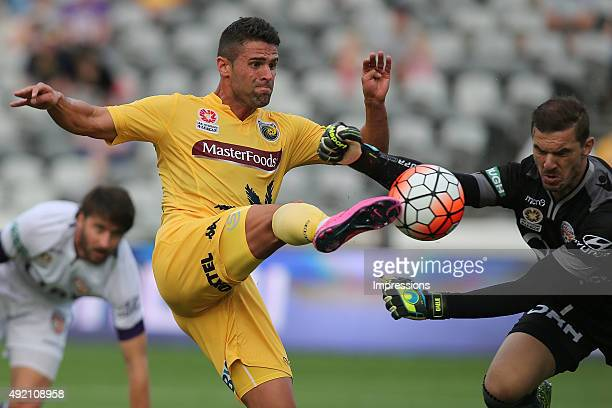 Fabio Ferreira of the Mariners contests the ball with Ante Covic of the Glory during the round one A-League match between the Central Coast Mariners...