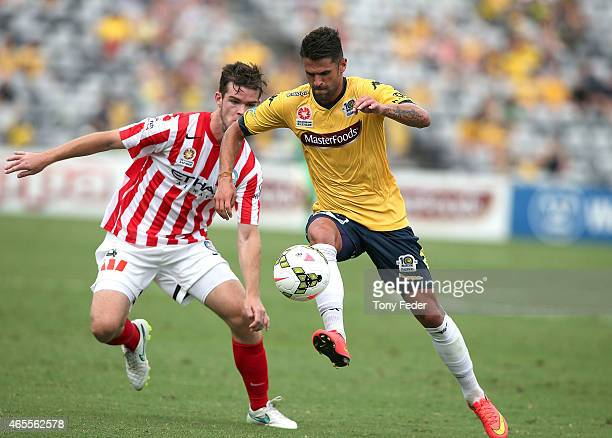 Fabio Ferreira of the Mariners contests the ball with Connor Chapman of Melbourne City during the round 20 ALeague match between the Central Coast...