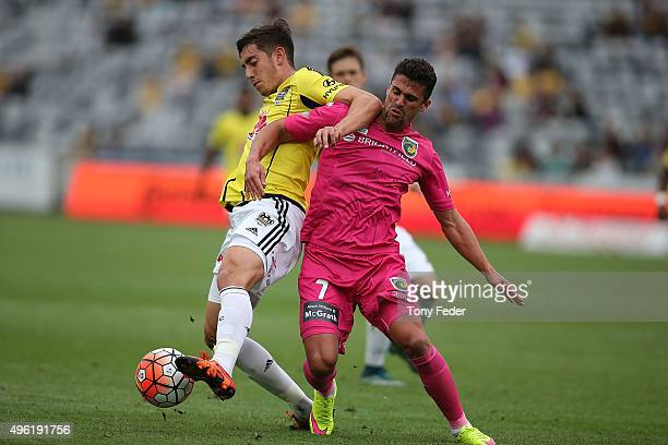 Fabio Ferreira of the Mariners contests the ball with his Phoenix opponent during the round five A-League match between the Central Coast Mariners...