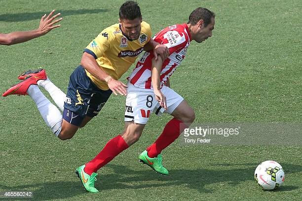 Fabio Ferreira of the Mariners is blocked by Massimo Murdocca of Melbourne City during the round 20 ALeague match between the Central Coast Mariners...