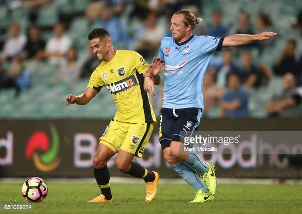 Fabio Ferreira of the Mariners is challenged by Rhyan Grant of Sydney FC during the round 23 ALeague match between Sydney FC and the Central Coast...
