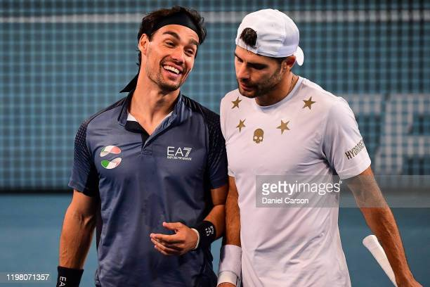 Fabio Fognini and Simone Bolleli of team Italy share a laugh during their doubles match against Team USA during day five of the ATP Cup Group Stage...