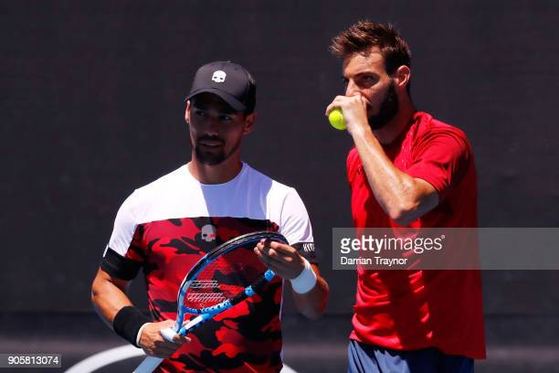 Fabio Fognini of Italy and Marcel Granollers of Spain talk tactics in their first round men's doubles match against Alex Bolt of Australia and...