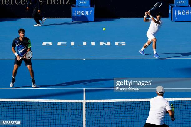 Fabio Fognini of Italy and Robin Hasse of the Netherlands in action during their Men's doubles quarterfinal match against Sebastian Cabal and Robert...