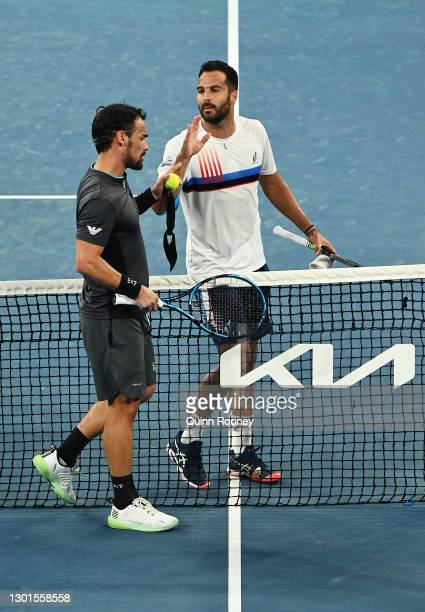Fabio Fognini of Italy and Salvatore Caruso of Italy exchange words following their Men's Singles second round match during day four of the 2021...