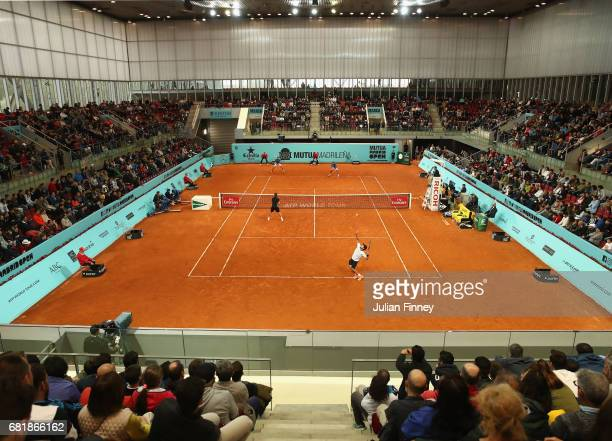 Fabio Fognini of Italy and Treat Huey of Philippinnes in action in their doubles match against Marcel Granollers of Spain and Ivan Dodig of Croatia...