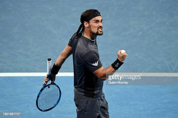 Fabio Fognini of Italy celebrates after winning a point in his Men's Singles second round match against Salvatore Caruso of Italy during day four of...