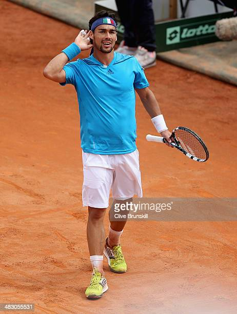 Fabio Fognini of Italy celebrates match point after his straight sets victory against Andy Murray of Great Britain during day three of the Davis Cup...