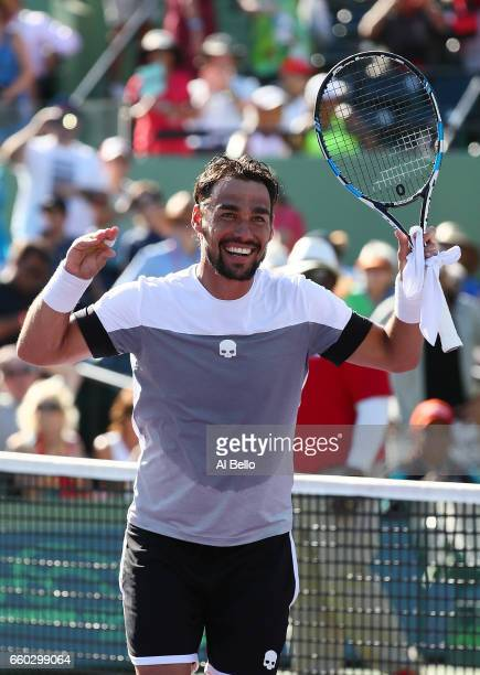 Fabio Fognini of Italy celebrates match point against Kei Nishikori of Japan during Day 10 of the Miami Open at Crandon Park Tennis Center on March...