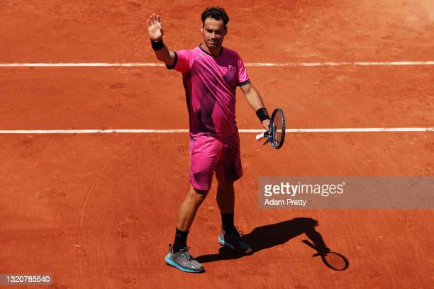 Fabio Fognini of Italy celebrates match point in his First Round match against Gregoire Barrere of France during Day One of the 2021 French Open at...