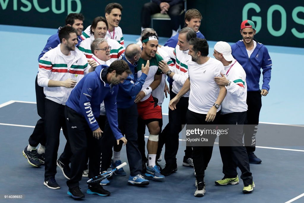 Fabio Fognini (C) of Italy celebrates the team's 3-1 victory with his team mates and team staff after winning his singles match against Yuichi Sugita of Japan during day three of the Davis Cup World Group first round between Japan and Italy at Morioka Takaya Arena on February 4, 2018 in Morioka, Iwate, Japan.