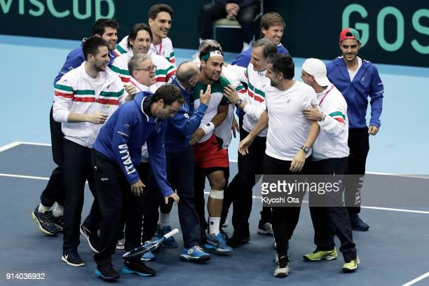 Fabio Fognini of Italy celebrates the team's 31 victory with his team mates and team staff after winning his singles match against Yuichi Sugita of...