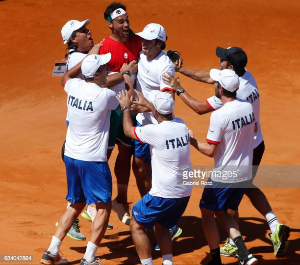 Fabio Fognini of Italy celebrates with teammates after winning the singles match between Guido Pella and Fabio Fognini as part of day 3 of the Davis...
