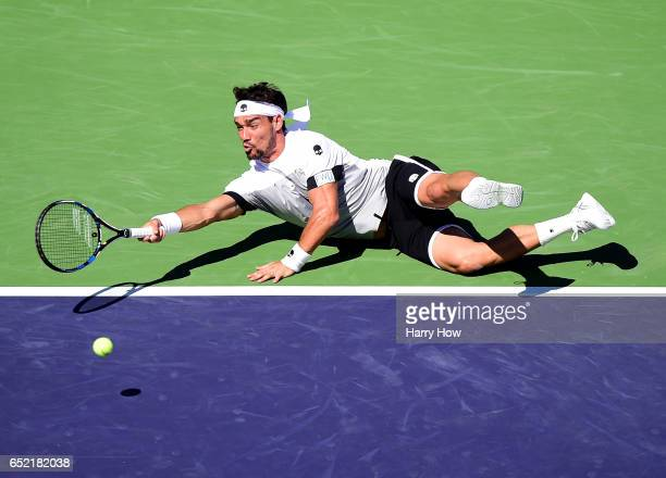 Fabio Fognini of Italy dives for a ball in his match against JoWilfried Tsonga of France during the BNP Paribas Open at Indian Wells Tennis Garden on...