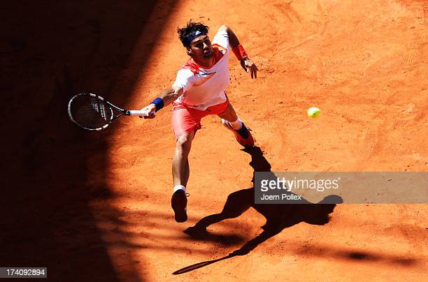 Fabio Fognini of Italy hits a forehand during his Semi Final match against Nicolas Almagro of Spain during the International German Open at...