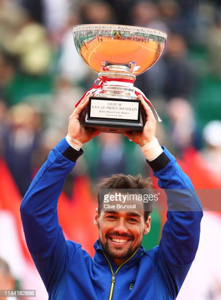 Fabio Fognini of Italy holds aloft the winners trophy after his straight sets victory against Dusan Lajovic of Serbia in the men's singles final...