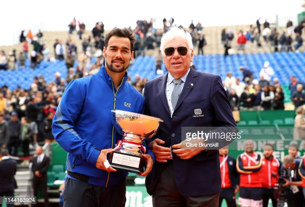 Fabio Fognini of Italy holds his winners trophy with the last Italian winner of the tournament in 1968 Nicola Pietrangeli after his straight sets...