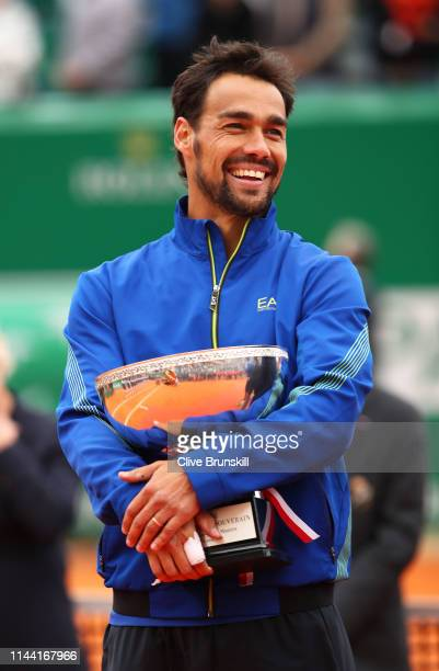 Fabio Fognini of Italy holds the winners trophy after his straight sets victory against Dusan Lajovic of Serbia in the men's singles final during day...