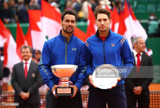 Fabio Fognini of Italy holds the winners trophy along with Dusan Lajovic of Serbia who holds his runners up trophy after the men's singles final...
