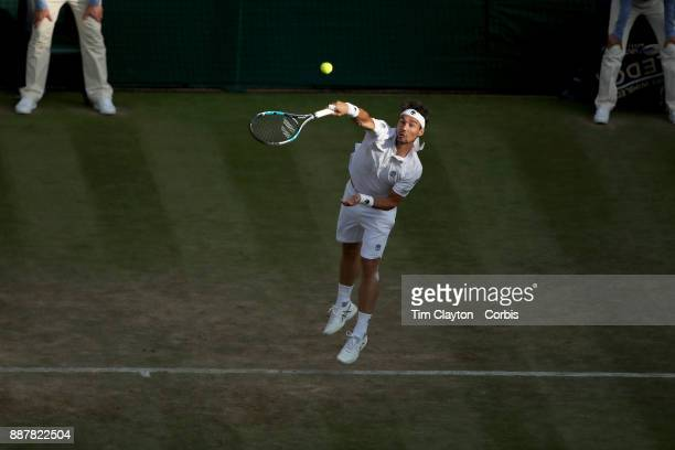 Fabio Fognini of Italy in action against Andy Murray of Great Britain on Centre Court in the Gentlemen's Singles competition during the Wimbledon...
