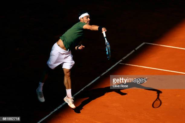 Fabio Fognini of Italy in action during his match against Rafael Nadal of Spain on day five of the Mutua Madrid Open tennis at La Caja Magica on May...
