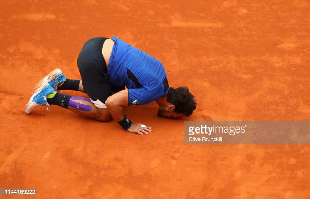 Fabio Fognini of Italy kisses the court after his straight sets victory against Dusan Lajovic of Serbia in the men's singles final during day eight...