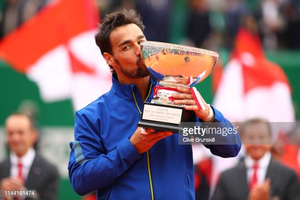 Fabio Fognini of Italy kisses the winners trophy after his straight sets victory against Dusan Lajovic of Serbia in the men's singles final during...