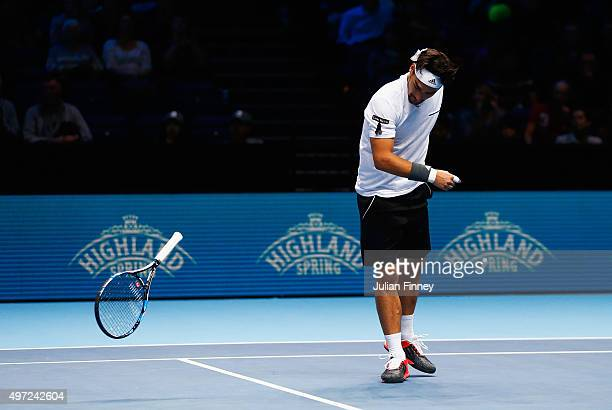 Fabio Fognini of Italy partnering Simone Bolelli of Italy throws his racket in frustration in their men's doubles match against Jamie Murray of Great...