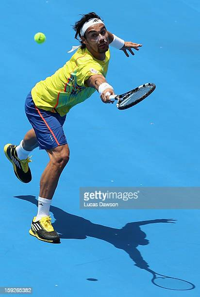 Fabio Fognini of Italy plays a backhand during his match against Milos Raonic of Canada during day three of the AAMI Classic at Kooyong on January...