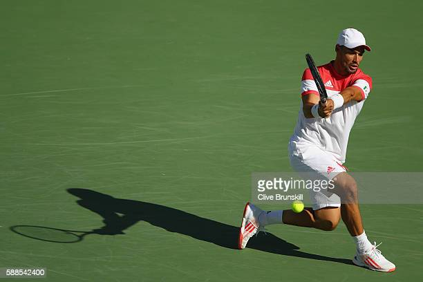 Fabio Fognini of Italy plays a backhand during the men's singles third round match against Andy Murray of Great Britain on Day 6 of the 2016 Rio...