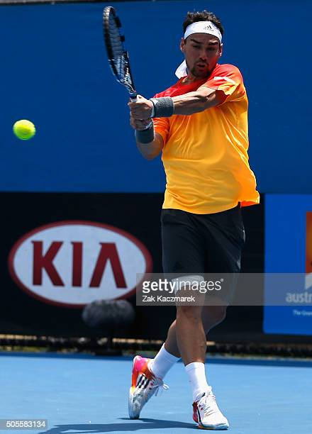 Fabio Fognini of Italy plays a backhand in his first round match against Gilles Muller of Luxembourg during day two of the 2016 Australian Open at...