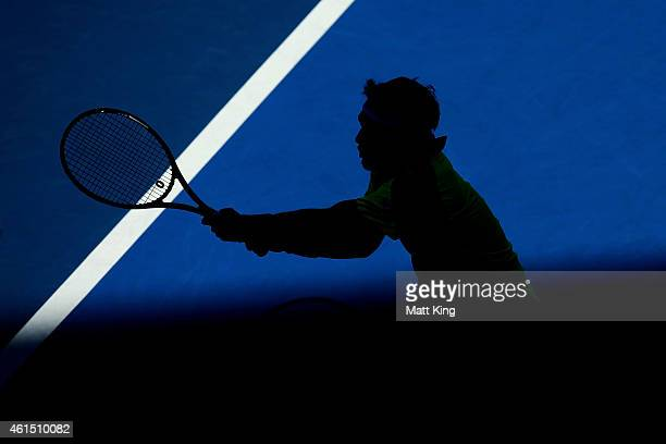 Fabio Fognini of Italy plays a backhand in his match against Juan Martin Del Potro of Argentina during day four of the 2015 Sydney International at...