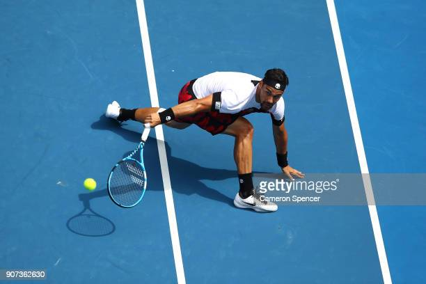 Fabio Fognini of Italy plays a backhand in his third round match against Julien Benneteau of France on day six of the 2018 Australian Open at...