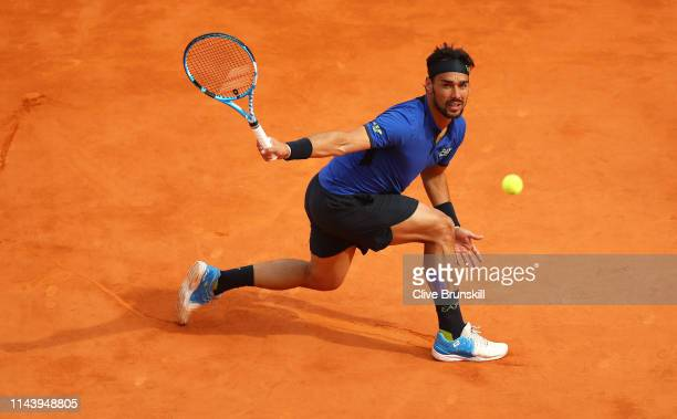 Fabio Fognini of Italy plays a backhand volley against Rafael Nadal of Spain in their semifinal match during day seven of the Rolex Monte-Carlo...