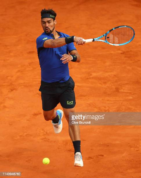 Fabio Fognini of Italy plays a forehand against Rafael Nadal of Spain in their semifinal match during day seven of the Rolex Monte-Carlo Masters at...