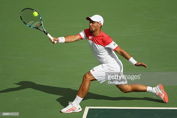 Fabio Fognini of Italy plays a forehand during the men's singles third round match against Andy Murray of Great Britain on Day 6 of the 2016 Rio...