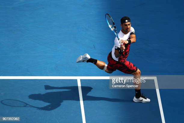 Fabio Fognini of Italy plays a forehand in his third round match against Julien Benneteau of France on day six of the 2018 Australian Open at...