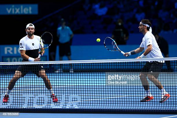 Fabio Fognini of Italy plays a forehand partnering Simone Bolelli of Italy in their men's doubles match against Rohan Bopanna of India and Florin...