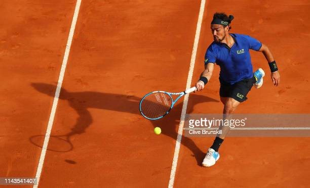 Fabio Fognini of Italy plays a forehand volley against Alexander Zverev of Germany in their third round match during day five of the Rolex...