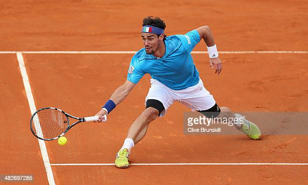 Fabio Fognini of Italy plays a forehand volley against James Ward of Great Britain during day one of the Davis Cup World Group Quarter Final match...