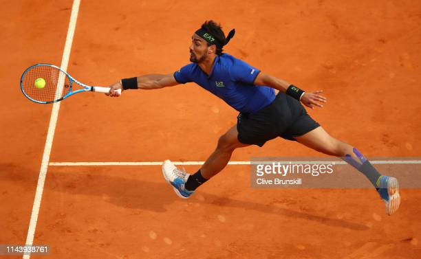 Fabio Fognini of Italy plays a forehand volley against Rafael Nadal of Spain in their semifinal match during day seven of the Rolex Monte-Carlo...