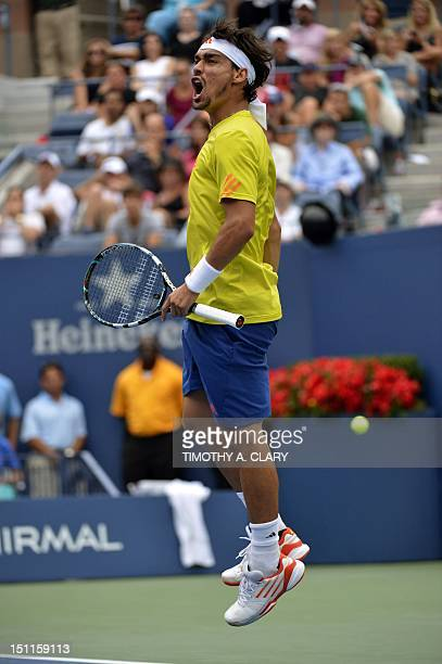 Fabio Fognini of Italy reacts after winning the third set against Andy Roddick of the US during their 2012 US Open men's singles third round match at...