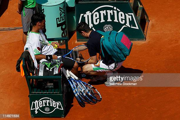 Fabio Fognini of Italy receives treatment from ATP physiotherapist Hugo Gravil during the men's singles round four match between Fabio Fognini of...