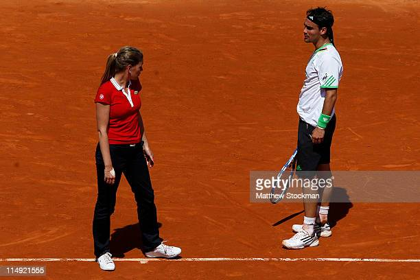 Fabio Fognini of Italy requests a medical timeout as he speaks with chair umpire Louise Engzell during the men's singles round four match between...
