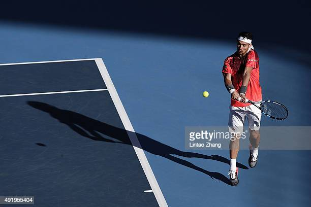 Fabio Fognini of Italy returns a ball against Pablo Cuevas of Uruguay on day 7 of the 2015 China Open at the National Tennis Centre on October 9 2015...
