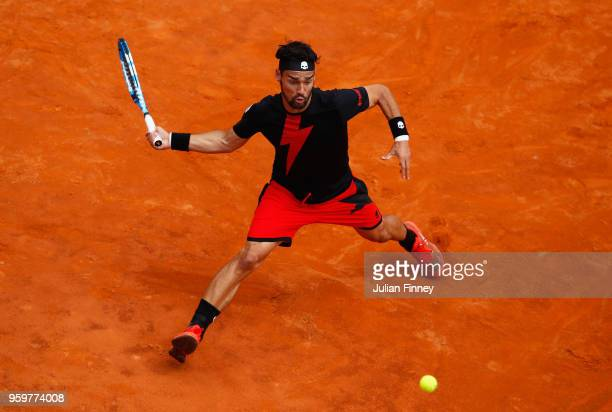 Fabio Fognini of Italy returns a forehand during his Quarter Final match against Rafael Nadal of Spain during day six of The Internazionali BNL...
